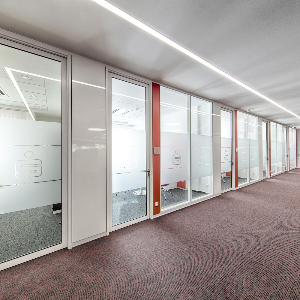 White partition wall sections with coloured e-panel