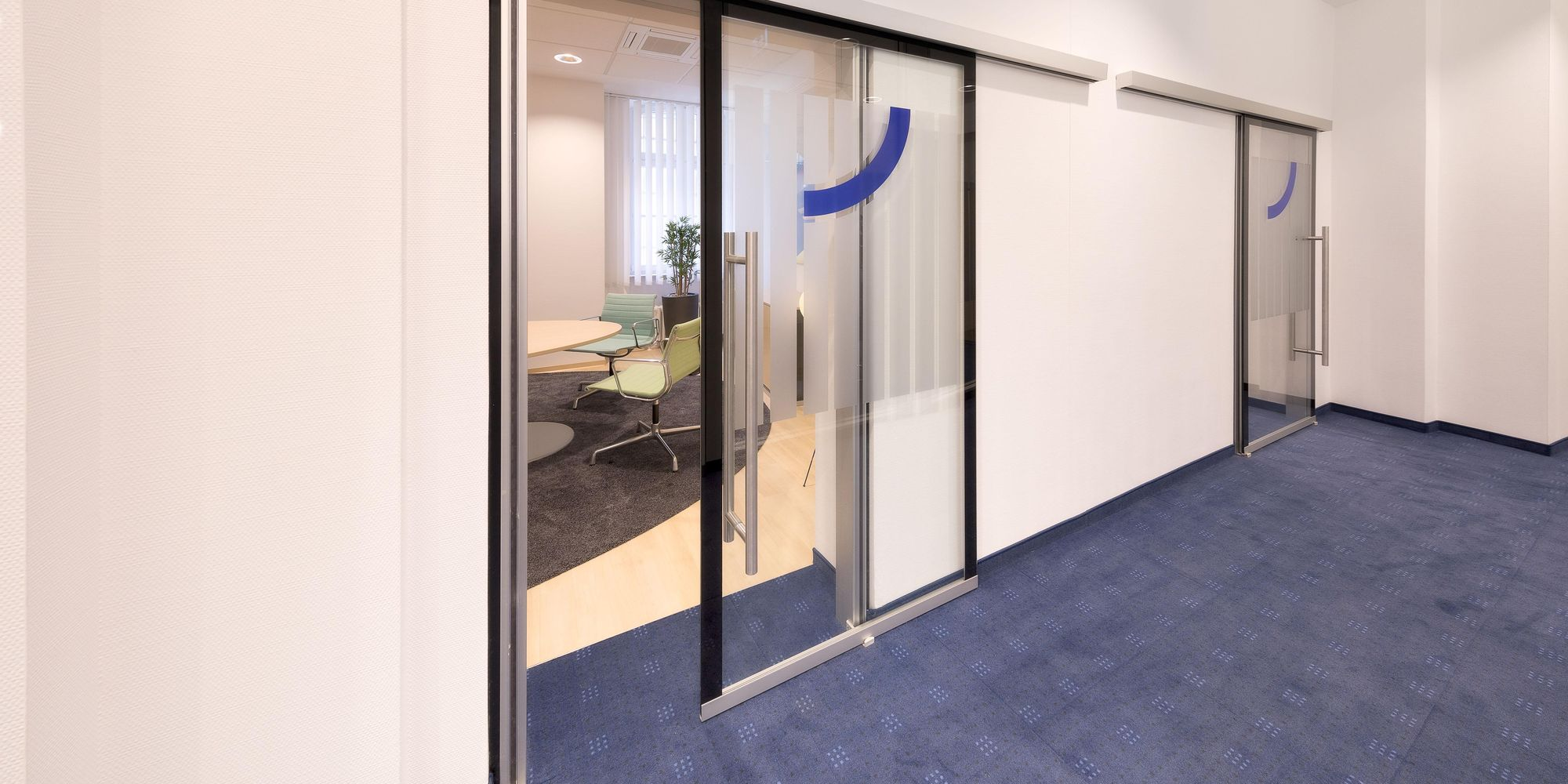 All-glass sound-insulating sliding door installed as front wall